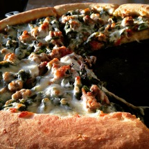 pizza with mustard greens and sausage